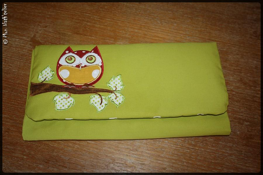 Embroidered wallet with applique design