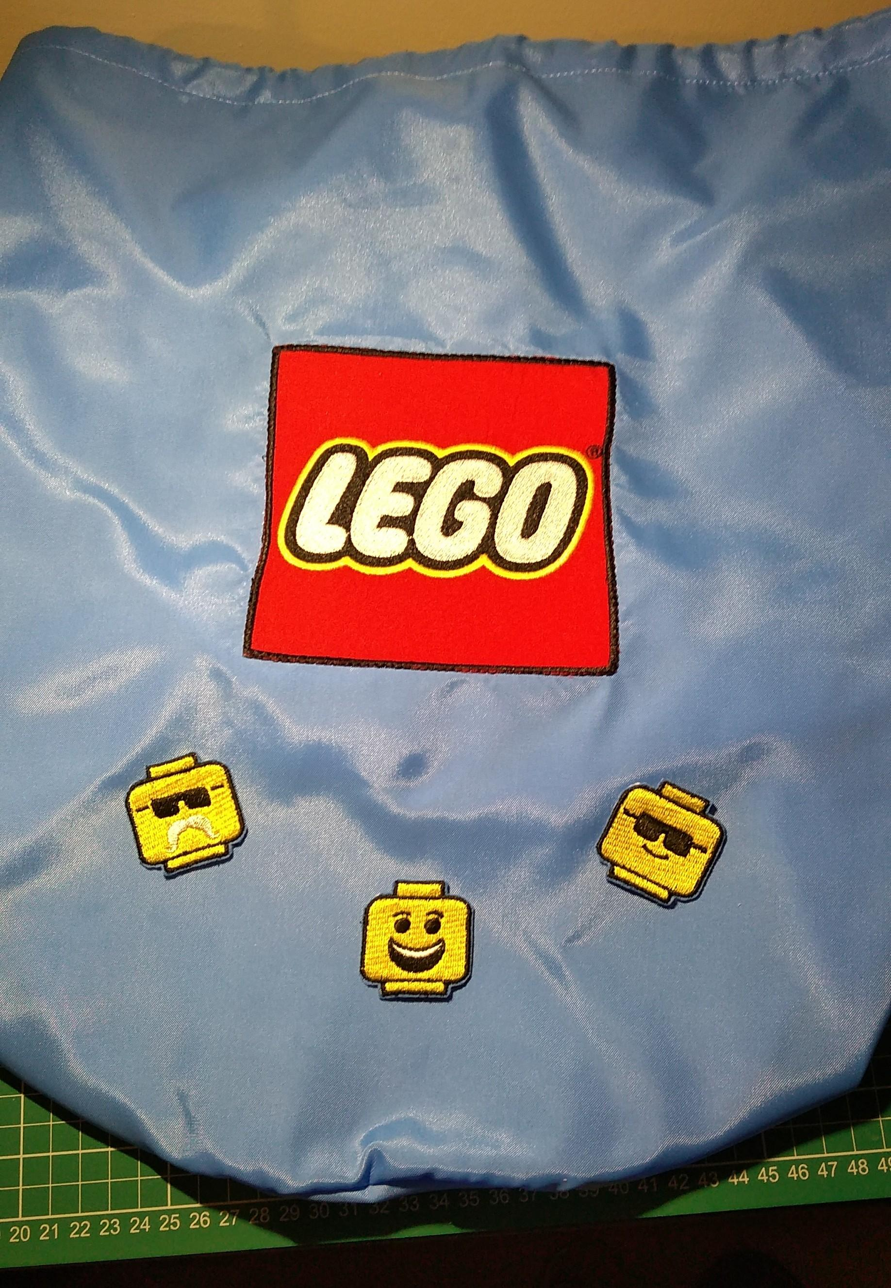Lego toy bag with Lego faces