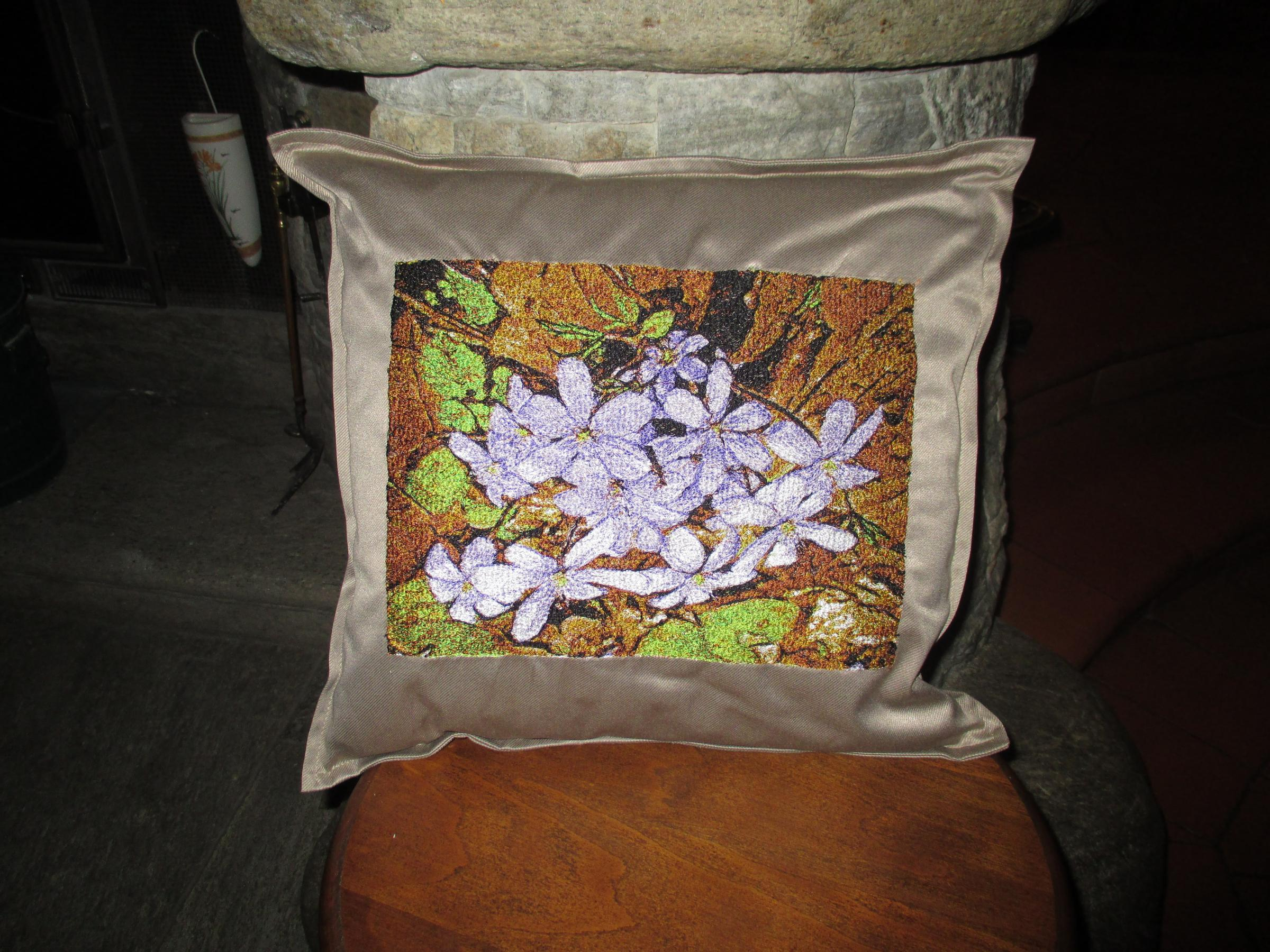 Embroidered pillow with spring flowers design