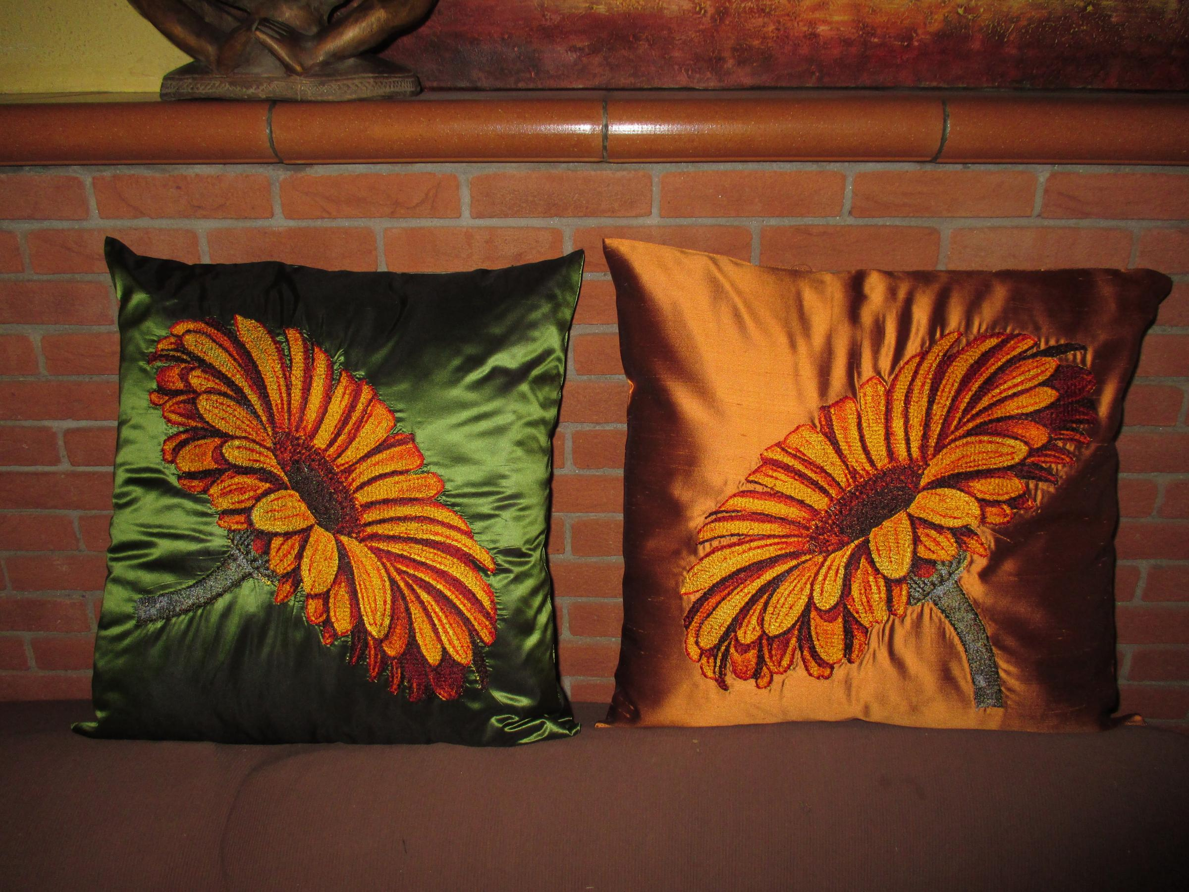 Set of embroidered cushions with Gerbera design