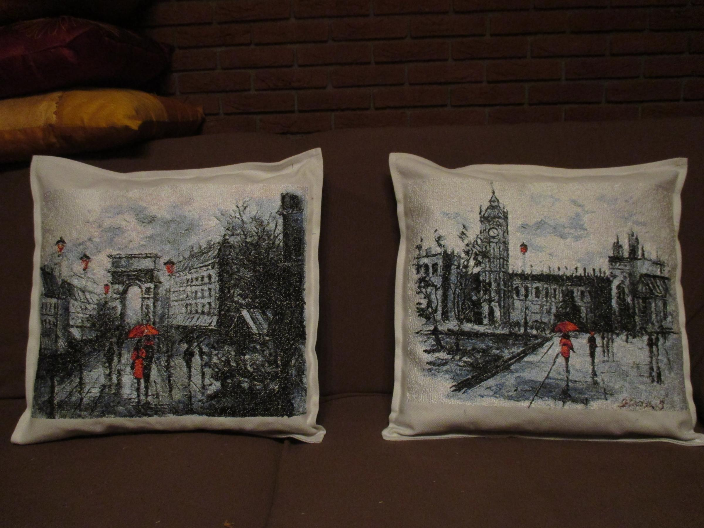 Embroidered cushions with city views designs