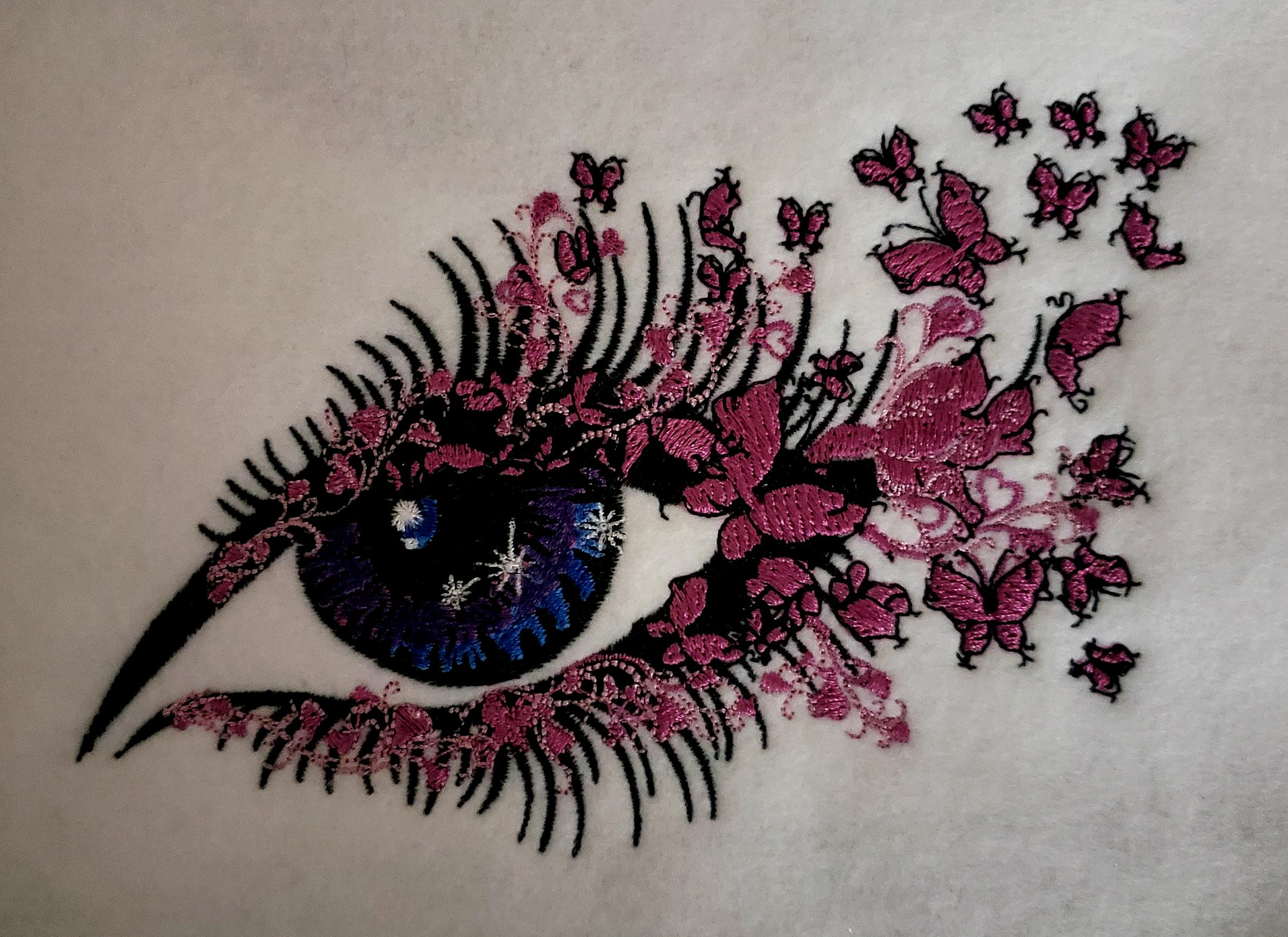 Pink sparkle eye embroidered design