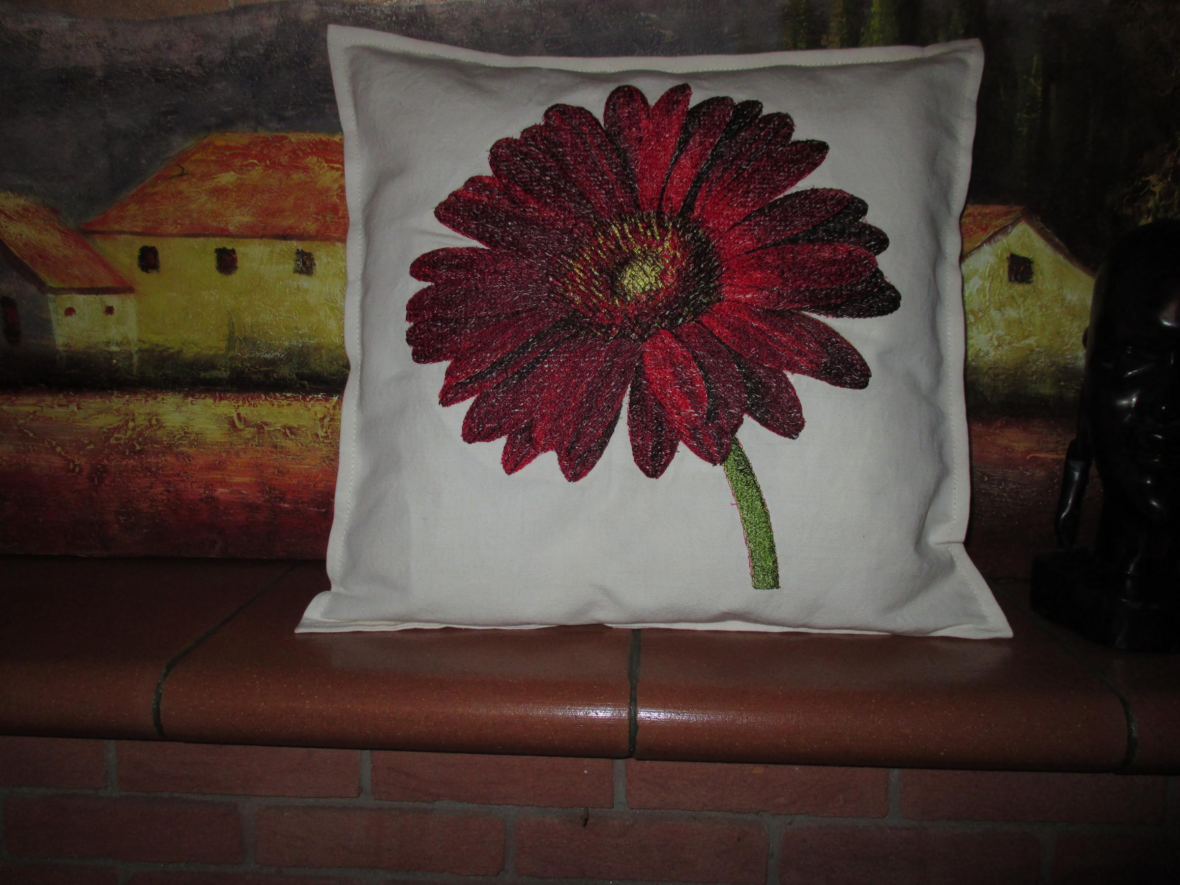 Embroidered cushion with Red flower design