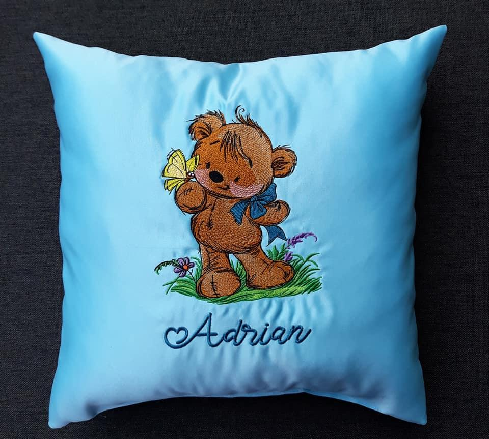 Embroidered cushion with Teddy bear and butterfly design