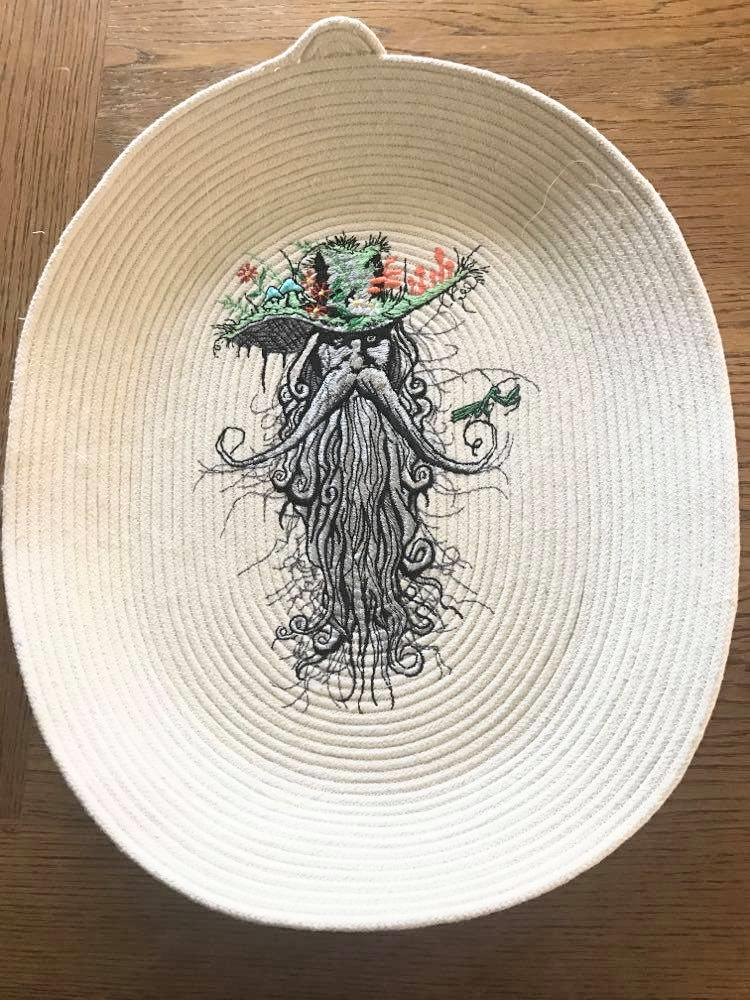 Embroidered textile plate with Rootman design