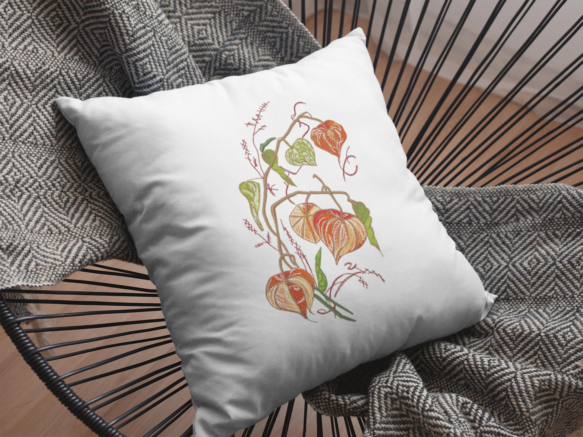 Embroidered cushion with Physalis design