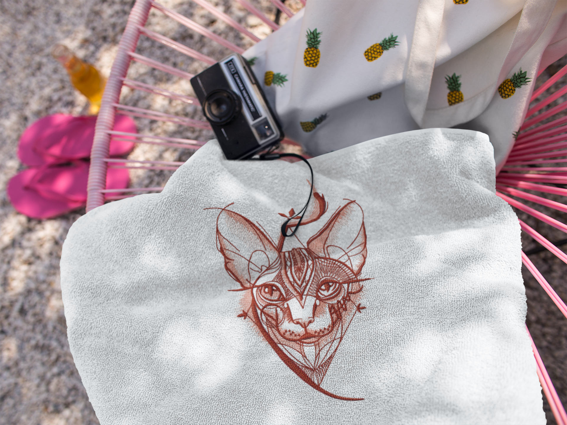 Embroidered towel with Sphynx design
