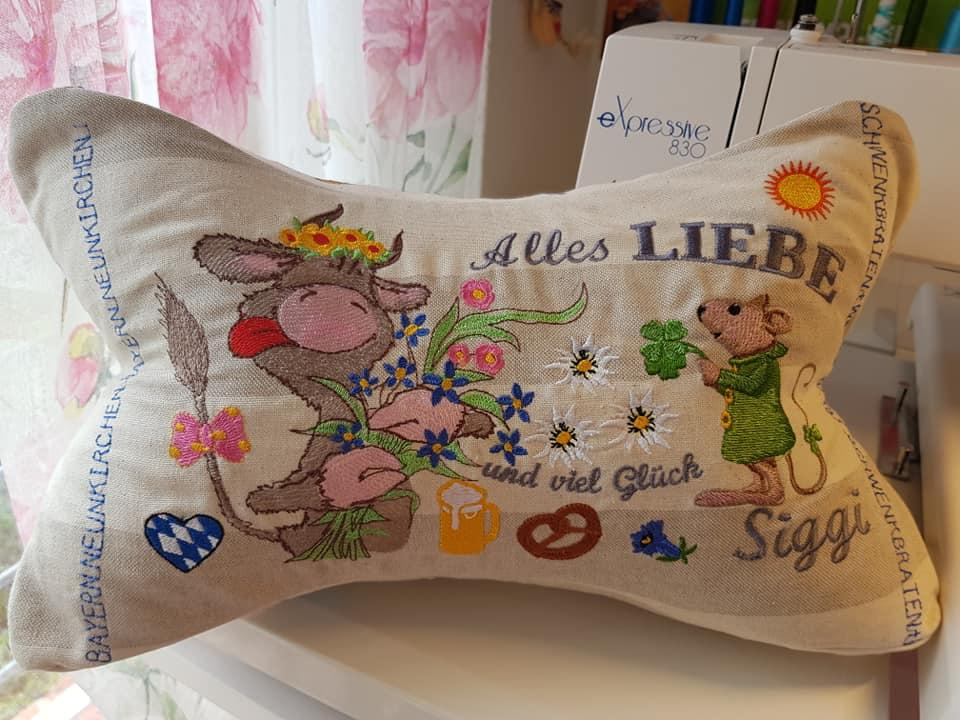 Embroidered cushion with animals designs