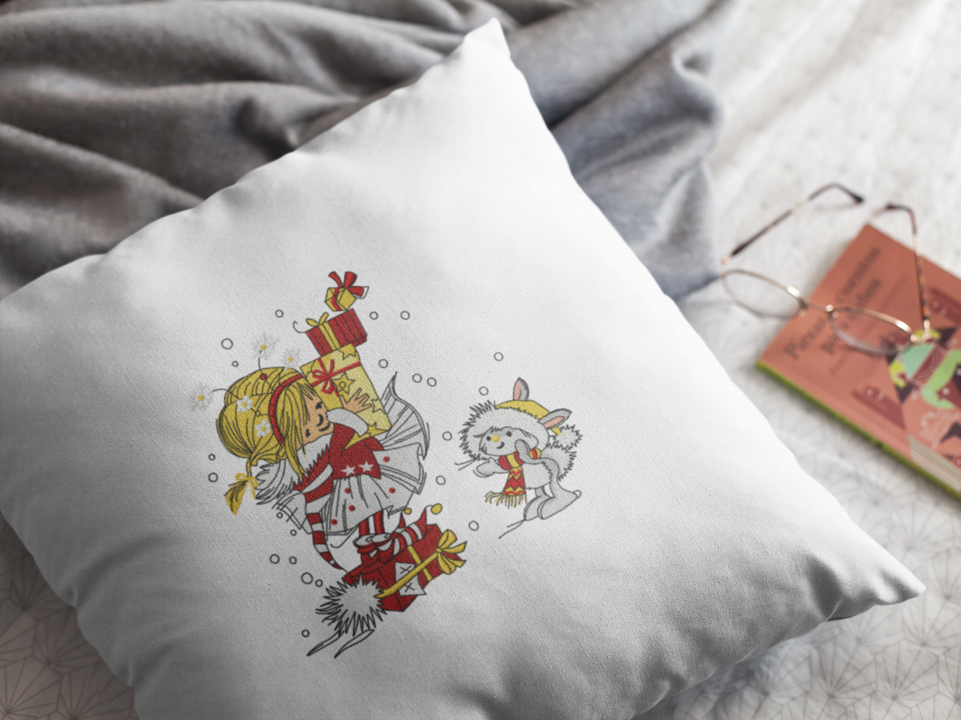 Embroidered cushion with Christmas gift design